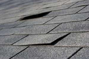 Damaged roof shingles in need of replacement | Advanced Roof Restoration
